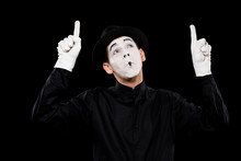 Grimacing Mime Pointing On Som...