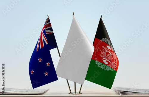 Flags of New Zealand and Afghanistan with a white flag in