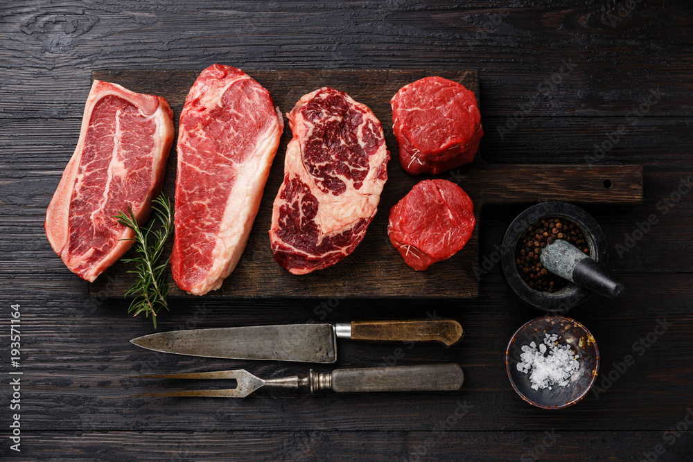 Photo  Variety of Raw Black Angus Prime meat steaks Blade on bone, Striploin, Rib eye,