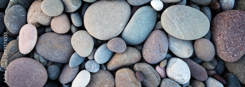 Fotografía Web banner abstract smooth round pebbles sea texture background