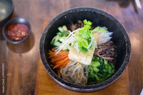 Bibimbap in a heated stone bowl korean style food