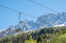 Cable Car With Sling To Mountain Peak In Chamonix Mont-Blanc Town In France