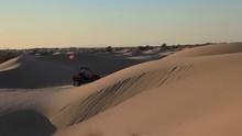 ATV Sand Rails Race Across Dunes In The Desert