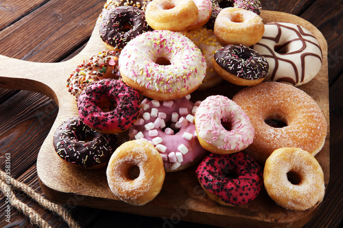Valokuvatapetti assorted donuts with chocolate frosted, pink glazed and sprinkles donuts