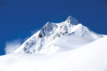 Winter Mountain With White Snow Peak In France