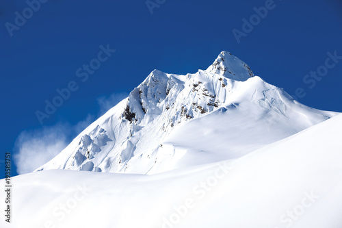 Foto op Aluminium Nachtblauw Winter mountain with white snow peak in France