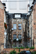 tenement house in the middle of city with old fashion brick wall