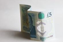 Five Pound Banknote On A White...