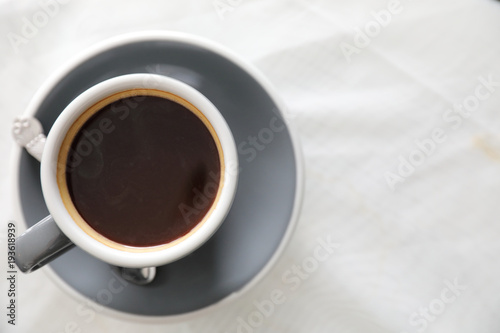 Foto op Plexiglas Cafe Coffee cup in white table