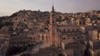 sunset flying clockwise around San Giorgio cathedral in Modica