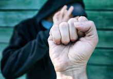 Person Threaten With A Fist
