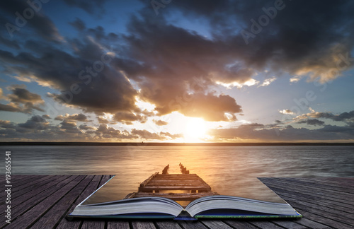 Foto  Creative book image of Beautiful vibrant sunset landscape image of Fleet Lagoon