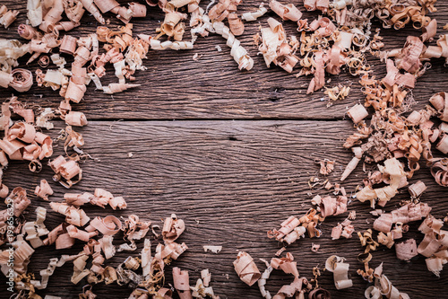 Fototapeta  wood sawdust on old vintage wooden background with free copy space