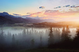 misty sunset over the mountains