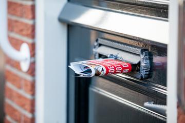 newspaper in door