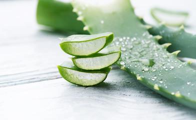 Aloe Vera closeup. Sliced Aloevera natural organic renewal cosmetics, alternative medicine. Organic skincare concept. On white wooden background