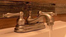 Rustic Bathroom Faucet With We...