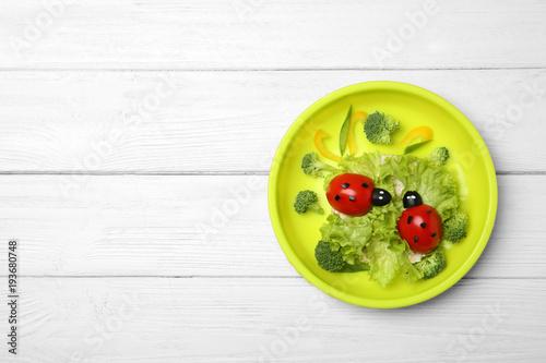 Creative breakfast for children on wooden background, top view