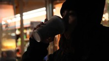 Transgender Teenager Takes A Sip Of Coffee On Cold Night