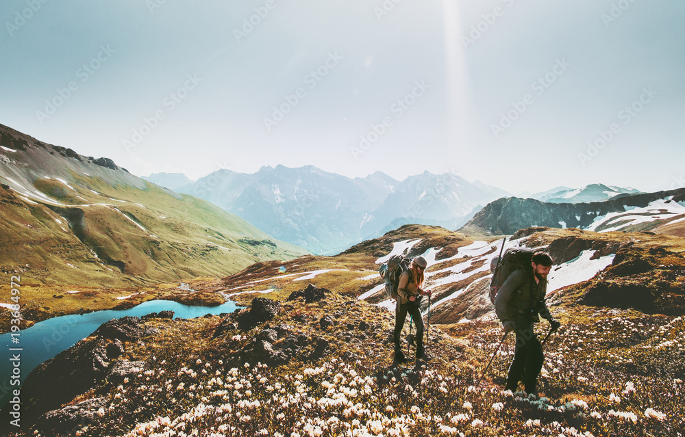 Fototapety, obrazy: Couple backpackers hiking together in mountains adventure travel lifestyle wanderlust concept active vacations outdoor
