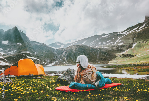 Poster Camping Camping travel in mountains vacations woman relaxing in sleeping bag on mat enjoying landscape Lifestyle concept adventure outdoor