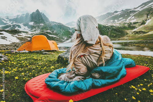 Montage in der Fensternische Camping Woman relaxing in sleeping bag on red mat camping travel vacations in mountains Lifestyle concept adventure weekend outdoor wild nature