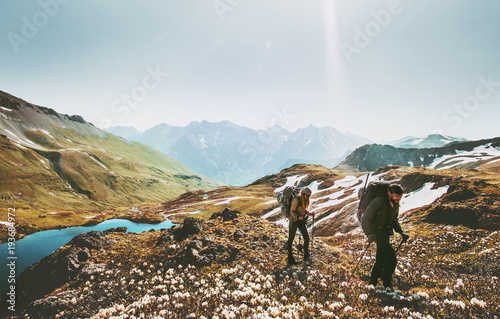 Fototapeta Couple backpackers hiking together in mountains adventure travel lifestyle wanderlust concept active vacations outdoor obraz