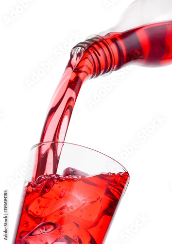 Fotografie, Tablou Pouring cranberry red juice from bottle to glass
