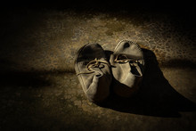 Old Shoes Of Children In Rural School