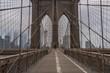 Brooklyn Bridge and New York City Manhattan skyline on the background on moody morning