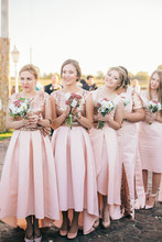 Row Of Bridesmaids With Bouque...