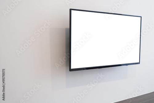 White blank screen television on concrete wall at living room. copy space for text on TV.