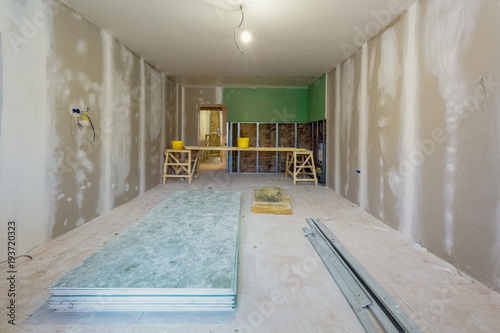 Working process of installing metal frames and plasterboard (drywall ...