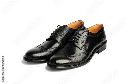 Foto op Plexiglas Dragen Male black shoes isolated on a white background