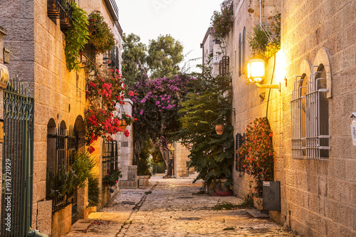 Poster Diepbruine Old area Mishkenot Shaananim in Jerusalem in the evening, Israel
