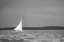 A Lone Bahamian C-Class Sailboat Racing In A Regatta Near Little Farmer's Cay In The Bahamas.