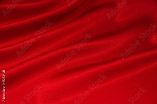 plakat red satin or silk fabric as background