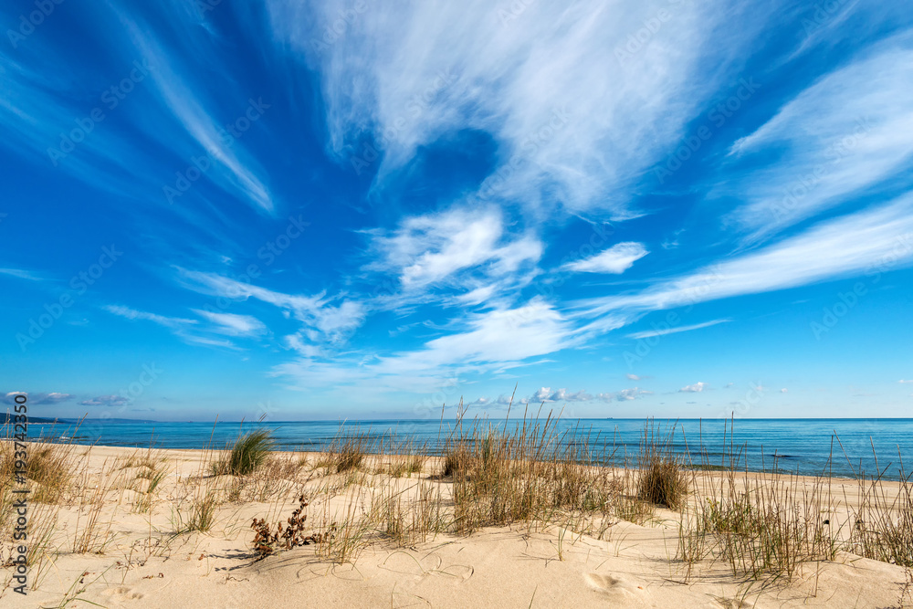 Fototapeta Seascape with dramatic blue sky and clouds