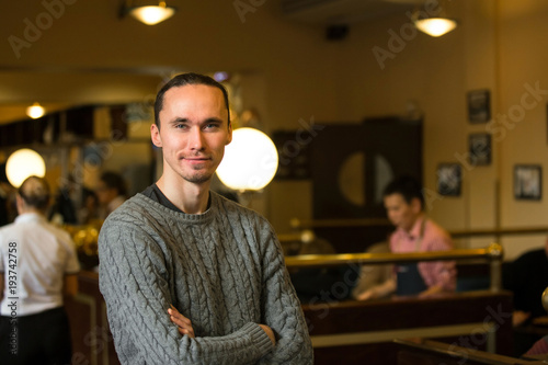 Valokuva  Smiling casual man in cafeteria