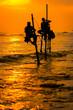 Leinwandbild Motiv Silhouettes of the traditional fishermen