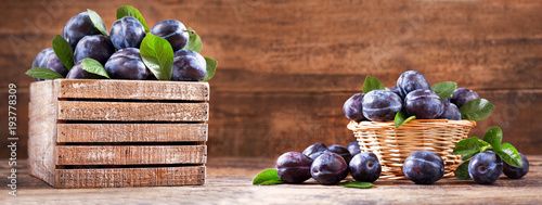 fresh plums with leaves in a wooden box Wallpaper Mural