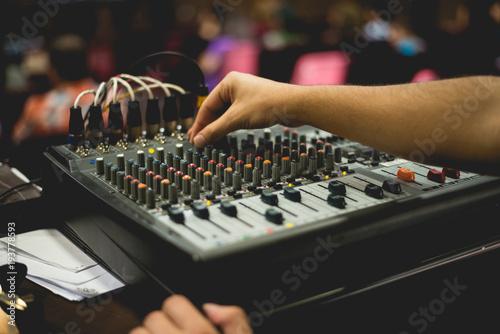 Fotografie, Obraz  hand tuning sound mixer