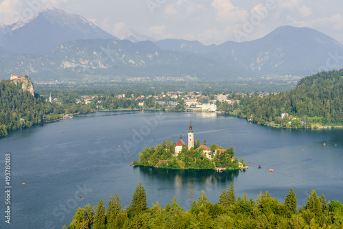 Fototapeta Colorful summer scene on the Bled lake with the famous Pilgrimage Church of the Assumption of Maria and Bled Castle and Julian Alps at background obraz na płótnie