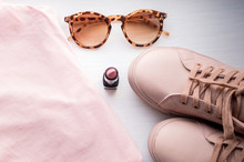 Pink Sneakers, Pink Tank Top, Glasses, Lipstick. Concept Beauty And Personal Care. Flat Lay