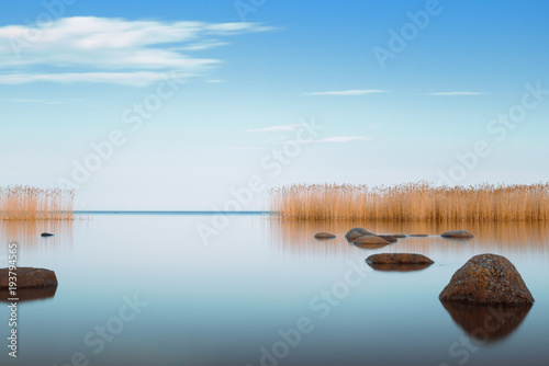 blue sky is reflected Ladoga lake in the evening Fototapet