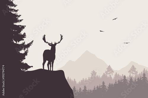 Rogacz z jelonkami stoi przy wierzchołkiem skała z górami i lasem w tle z latającymi ptakami ,.