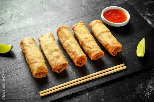 Chinese vegetable spring rolls with lime wedges, sweet chilli sauce Wallpaper Mural