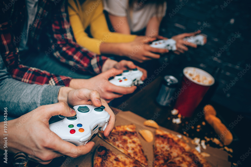Fototapety, obrazy: Close up of four gaming consoles that all for people getting in their hands. The company is ready to start fighting for the first place and want to push buttons as soon as sossible.