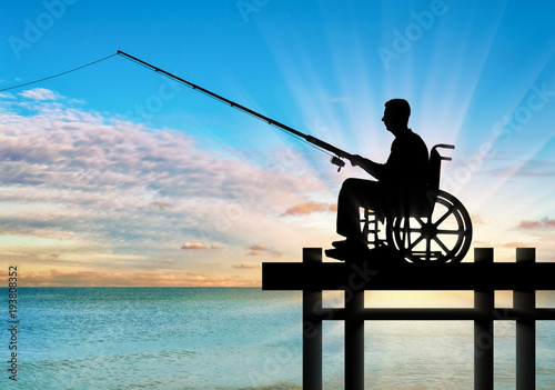 Silhouette of a disabled man in a wheelchair with a fishing rod in his hand fish Tapéta, Fotótapéta