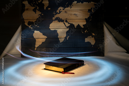 Light of the World Light Painting of Holy Bible with Map